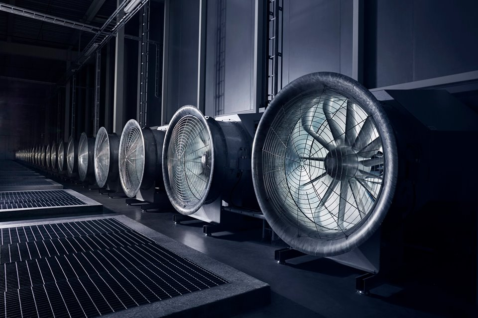 I love this shot because it looks like a sci-fi movie. These enormous fans draw in the outside air to cool the tens of thousands of servers in the data hall. In the winter, when temperatures plunge to -30 degrees the situation is reversed, and the heat from the servers warm the massive buildings.